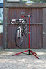 Feedback Sports Pro-Elite Bike Work Stand w/ Tote Bag - Ratchet Clamp - Aluminum - Red Anodize Red and Black 301-16020
