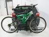 0  hitch bike racks curt platform rack tilt-away fold-up on a vehicle