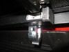 0  tonneau covers extang fold-up hard plastic and fiberglass encore cover - folding fiberglass-reinforced locking black matte