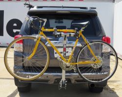 Hitch-mounted hanging style bicycle carrier installed on vehicle
