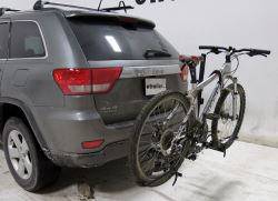 Platform style hitch-mounted bicycle carrier mounted on vehicle