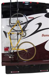 Ladder mounted bicycle carrier on RV ladder with with bicycle installed