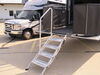 0  rv and camper steps lippert components deck patio motorhome towable snap-on step victory manual fold-down for toy hauler patios - quadruple aluminum