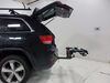 2014 jeep grand cherokee hitch bike racks kuat platform rack fold-up tilt-away on a vehicle