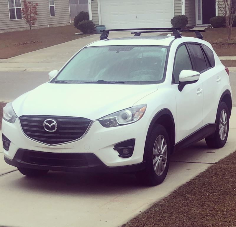 Love my new CX-5! .hate the roof rails. Are they easy