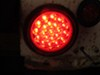 Optronics LED Trailer Tail Light - Stop, Tail, Turn - Submersible - 21 Diodes - Round - Red Lens Stop/Turn/Tail STL55RB