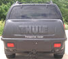 Thule Enclosed Carrier - TH665C on 2005 Nissan Pathfinder