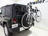 Thule Dual Arm Spare Tire Bike Racks - TH963PRO on 2015 Jeep Wrangler Unlimited