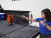 0  truck bed accessories truxedo retriever hook in use